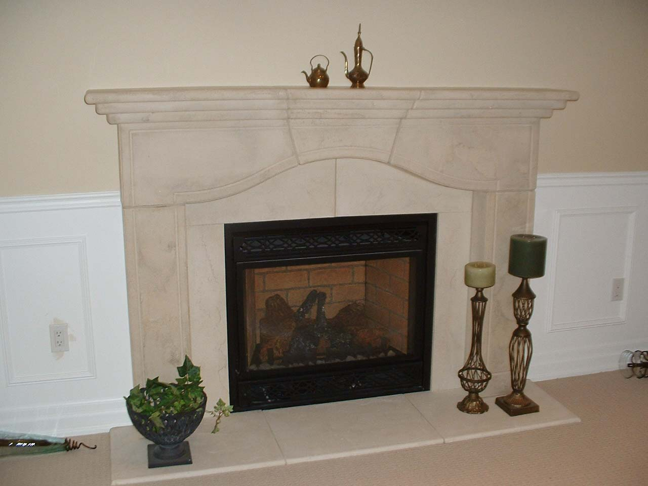 Fire place and mantle in basement renovation.